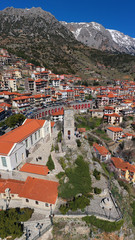 Aerial drone photo from famous and picturesque village of Arachova built on the slope of Parnassus mountain with traditional character at spring, Voiotia, Greece © aerial-drone