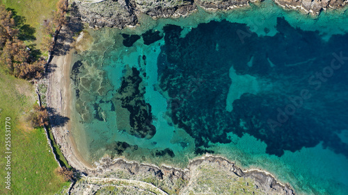 Aerial drone photo of tropical caribbean bay with white sand beach and beautiful turquoise and sapphire clear sea © aerial-drone
