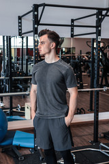 A portrait of a young strength athlete in a gym. muscle, athlete sporty, sport, workout, gymclothing