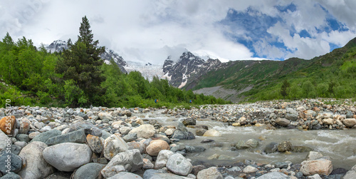 Mountain river Adishtchala flowing from glacier Lardaad on mount Tetnuldi. © dzmitrock87