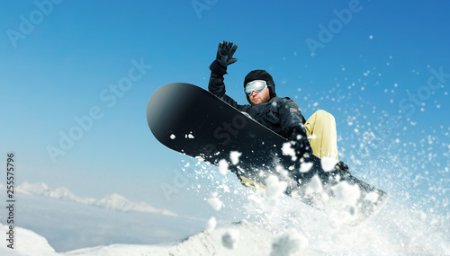 obraz lub plakat Male snowboarder, dangerous downhill in action