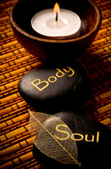 Wellness and spa concept with healing stones body and soul, candle © starblue