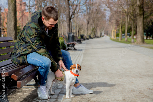 Young man with his dog, Jack Russell Terrier,