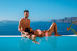 young couple on vacation in Santorini Greece, luxury holliday vacation Oia Santorini Greece