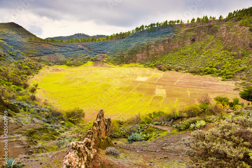 Lanscape with cultivated fields in valley between mountains at Canary islands. Gran Canaria, Spain