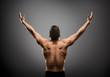 Leinwandbild Motiv Athletic Man Raised Open Arms, Muscular Athlete Body Back Rear View over gray studio Background