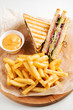 Club Sandwich with Cheese, PIckled Cucmber, Tomato and Smoked Meat. Garnished with French Fries - 255687130