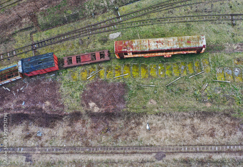 Aerial view on sidetrack with old, rusted train wagons.