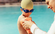 Boy getting ready for swimming lessons at pool