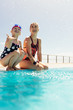 Girl with a woman having fun at poolside