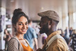 Pleasant loving afro American man looking at his beautiful girlfriend