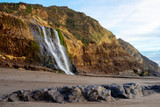 View of Alamere falls in Point Reyes near sunset with Rocks in Foreground