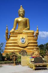 February 13, 2019. Phuket, Thailand. Golden Buddha statue near the huge sculpture of the Great white Buddha in Phuket. © taushka