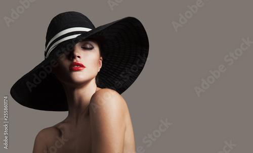 Leinwanddruck Bild Elegant lady in hat. Fashion portrait. Red lips.