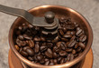 Close up of coffee beans in copper coffee grinder