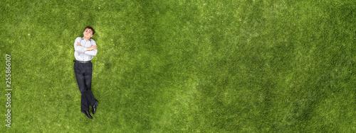 Leinwanddruck Bild Kid relaxing on grass