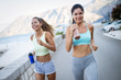 Leinwanddruck Bild - Happy people jogging outdoor. Running, sport, exercising and healthy lifestyle concept