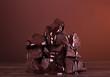 Leinwanddruck Bild - Pieces of flavored chocolate molten glaze on dark background