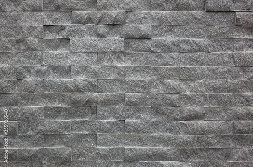 gray brick wall with rough texture - 255926540