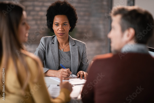 African American financial advisor having a meeting with a couple.