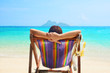 Summer beach vacation concept, woman resting on the beach chair of Phi Phi island, Thailand.