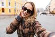 Leinwanddruck Bild - Beautiful young blonde woman wearing a coat