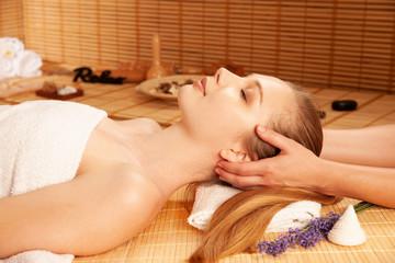 Beautiful young woman having a face massage in spa salon - wellness © Samo Trebizan