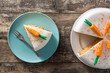 Sweet carrot cake slice on wooden table. Top view