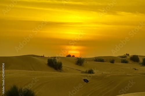 obraz lub plakat Sunset in Dubai's desert