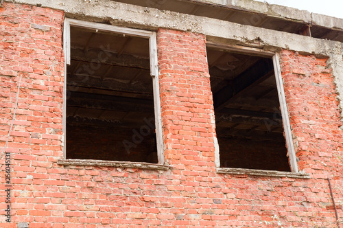 Window in a red brick wall - 256045131