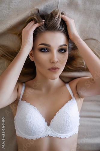 Portrait of a girl in a white bra - 256046904
