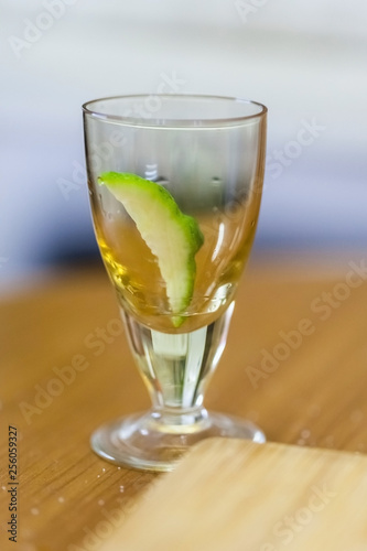 stack with lime slice on wooden table, close up, blurry background - 256059327