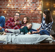 Portrait of a cheerrful family relaxing in a stylish interior