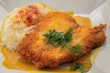 Schnitzel fried from grated potatoes and veal with butter, egg and smoked red pepper. Garnished with mustard sauce with celery. - 256067575