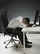Leinwanddruck Bild - Tired businessman having a nap on the desk