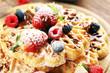 Leinwanddruck Bild - Waffle. Traditional belgian waffles with fresh fruit and powder sugar on wood