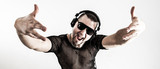 DJ - rapper in a stylish t-shirt with headphones and with hands