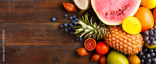 Ripe fruit on a wooden background - 256100301