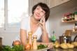Leinwanddruck Bild - Housewife talking on mobile phone