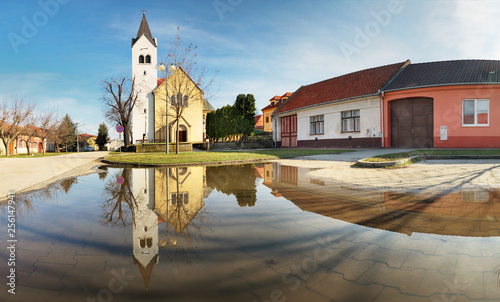 Church in Slovakia village Cifer with reflection