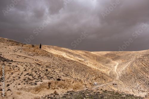 Dry stony landscape before storm around Shobak castle in Jordan