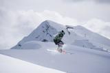 Flying skier on snowy mountains. Extreme winter sport, alpine ski.