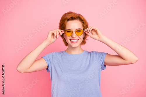 Leinwanddruck Bild Portrait of her she nice cute charming attractive lovely cheerful cheery girl wearing casual blue t-shirt touching cool yellow glasses isolated over pink pastel background