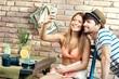 Loving couple making selfie on summer holiday