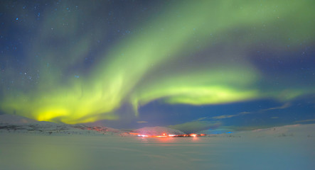 Northern lights in the sky over Tromso, Norway