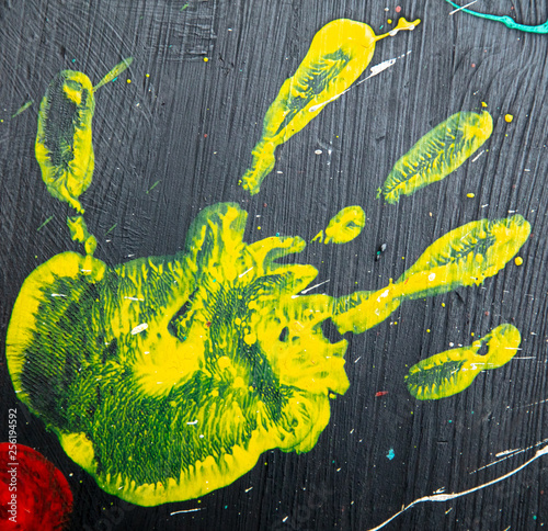 Handprint yellow paint as background