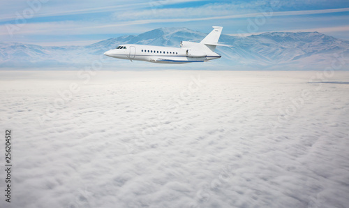 Luxury design private jet flying over the clouds and sea