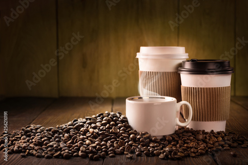 Coffee cup and coffee beans on wooden table © bioraven
