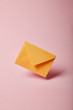 yellow and colorful envelope on pink background with copy space