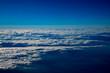 高空より雲間に海や地上が覗く風景が美しい - 256222197